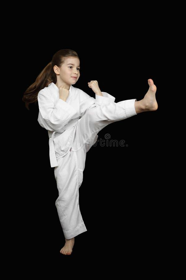 Jong karatemeisje stock foto