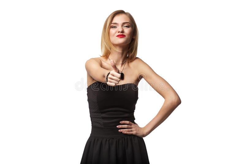 Jong leuk glimlachend emotioneel meisje die u geïsoleerde duim opgeven, stock afbeelding