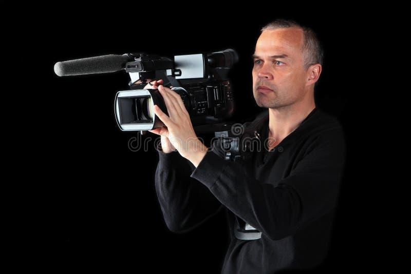 Jong mannetje dat videographer bij nacht ontspruit royalty-vrije stock afbeeldingen