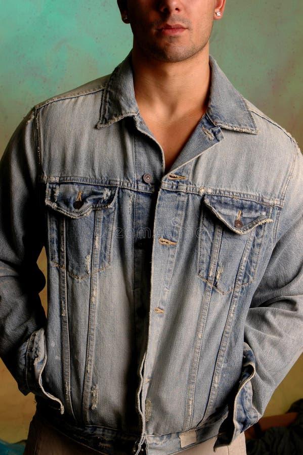 Jong mannetje in denimjasje stock afbeelding