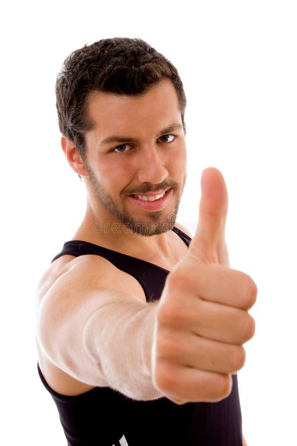 Jong mannetje met omhoog duimen royalty-vrije stock afbeelding