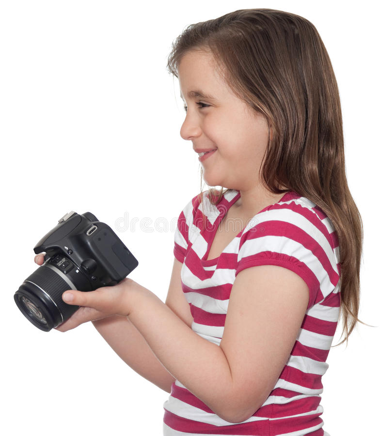 Jong meisje dat en een camera glimlacht houdt stock fotografie