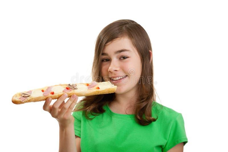 Jong meisje dat grote sandwich eet royalty-vrije stock foto's