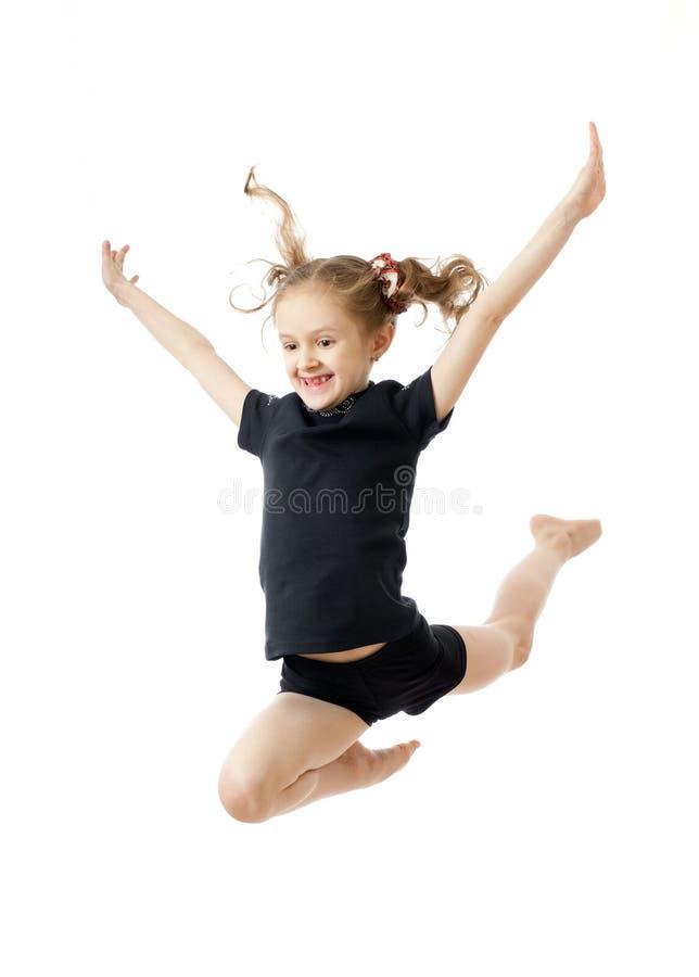 Jong meisje dat gymnastiek doet royalty-vrije stock afbeeldingen