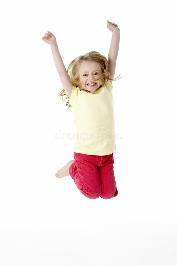 Jong Meisje dat in Lucht springt royalty-vrije stock afbeelding