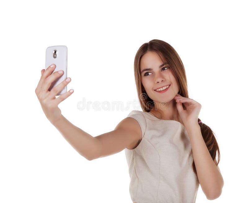 Jong meisje die fotograferen met mobiele telefoon stock foto
