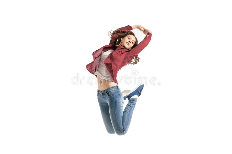 Jong meisje die over witte achtergrond dansen royalty-vrije stock foto