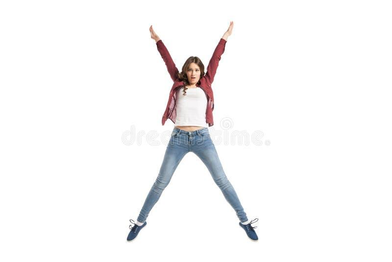 Jong meisje die over witte achtergrond dansen stock fotografie