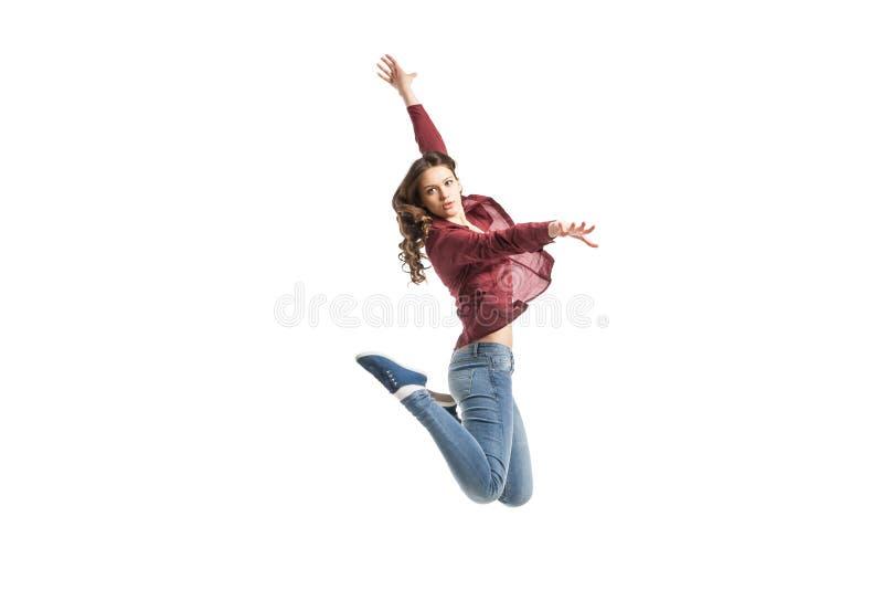 Jong meisje die over witte achtergrond dansen royalty-vrije stock foto's