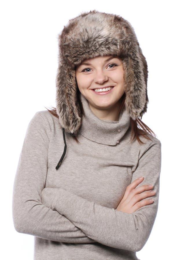 Jong meisje in een de winterhoed op wit stock foto