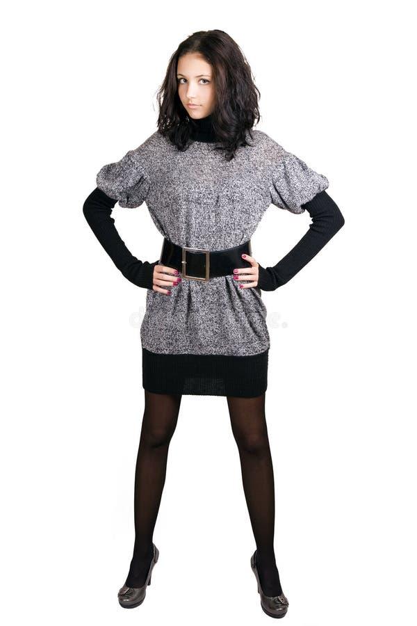 Jong meisje in een grijze kleding stock fotografie