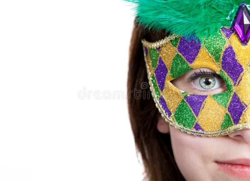 Jong meisje in een masker van mardigras met exemplaarruimte stock afbeeldingen
