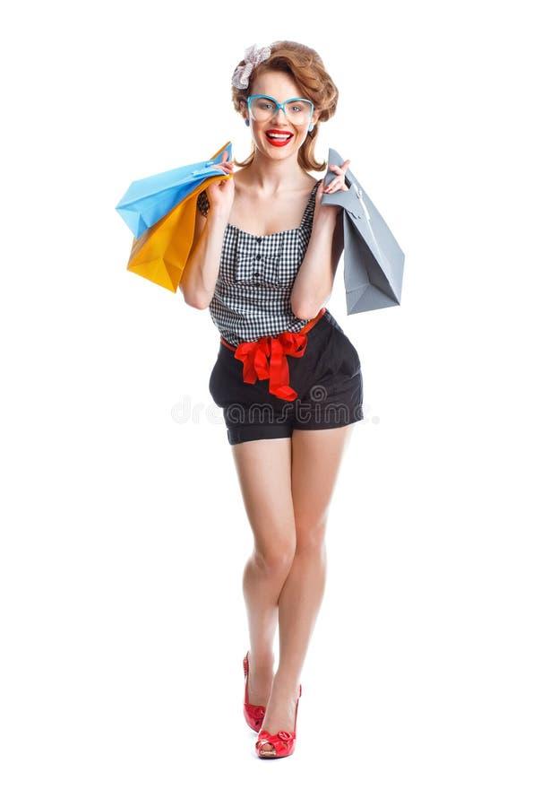 Jong meisje in het winkelen stock fotografie