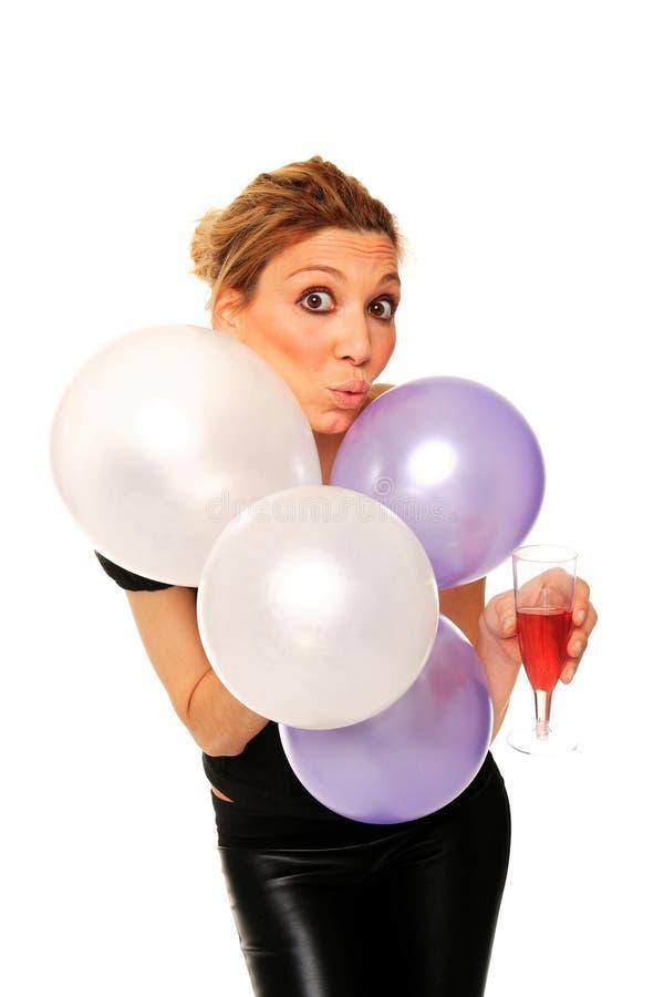 Jong meisje met ballons en glas champagne stock foto's