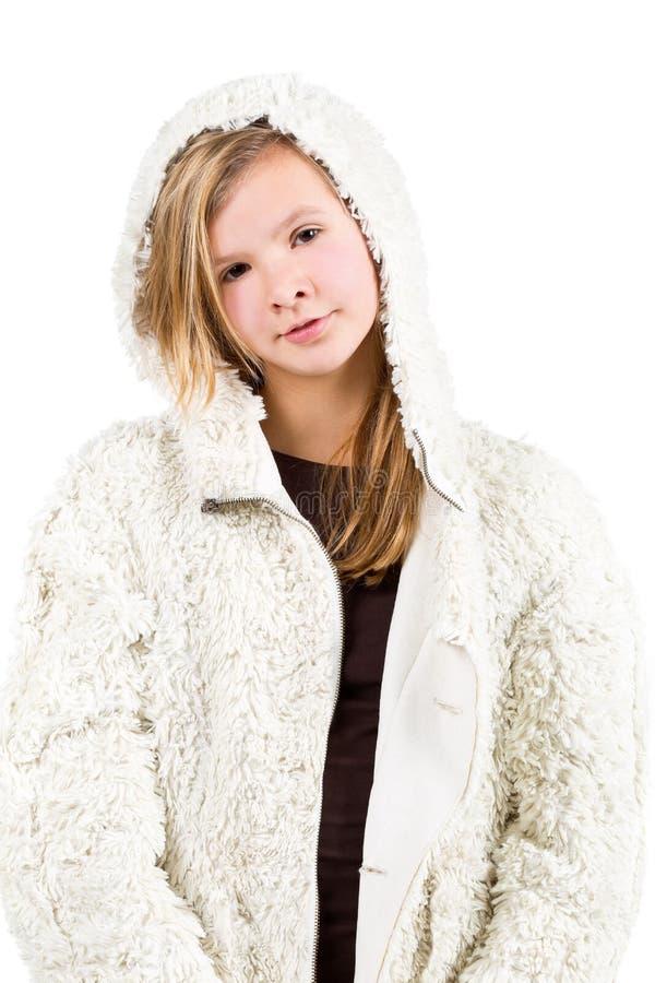 Jong meisje met de winterjasje stock afbeelding
