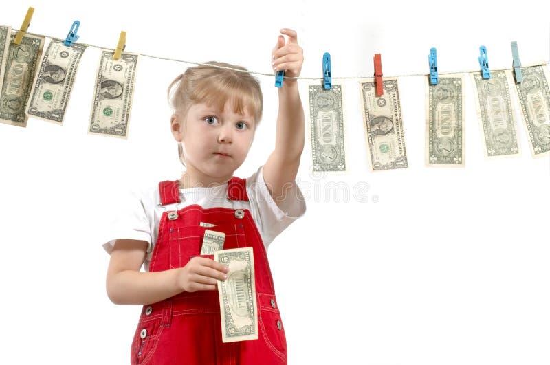 Jong meisje met dollars stock afbeelding
