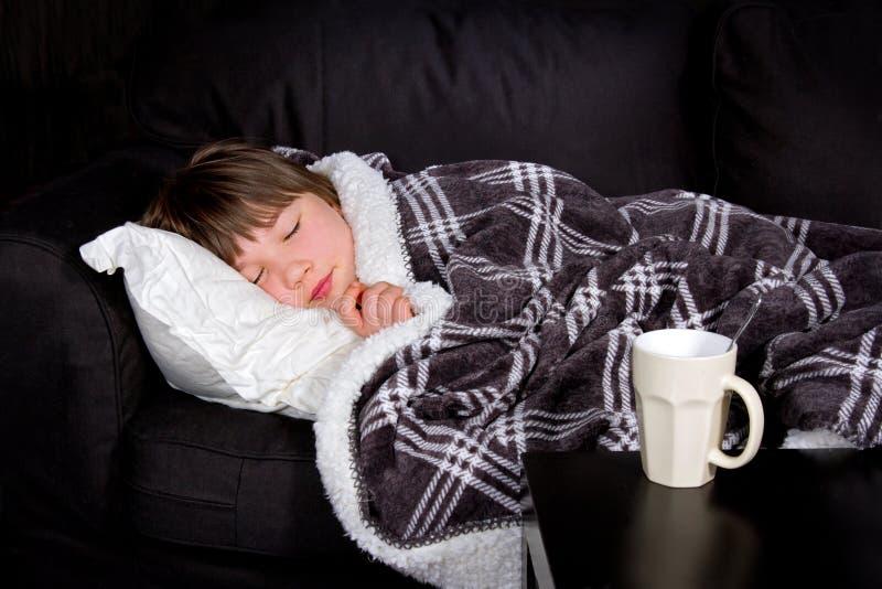 Jong meisje met een griep stock fotografie