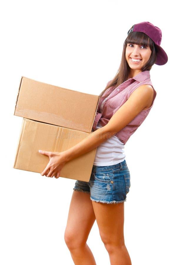 Jong meisje met kartondozen royalty-vrije stock afbeelding