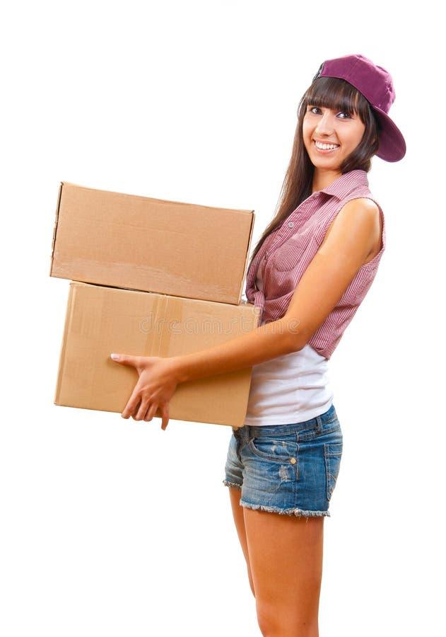 Jong meisje met kartondozen stock afbeeldingen