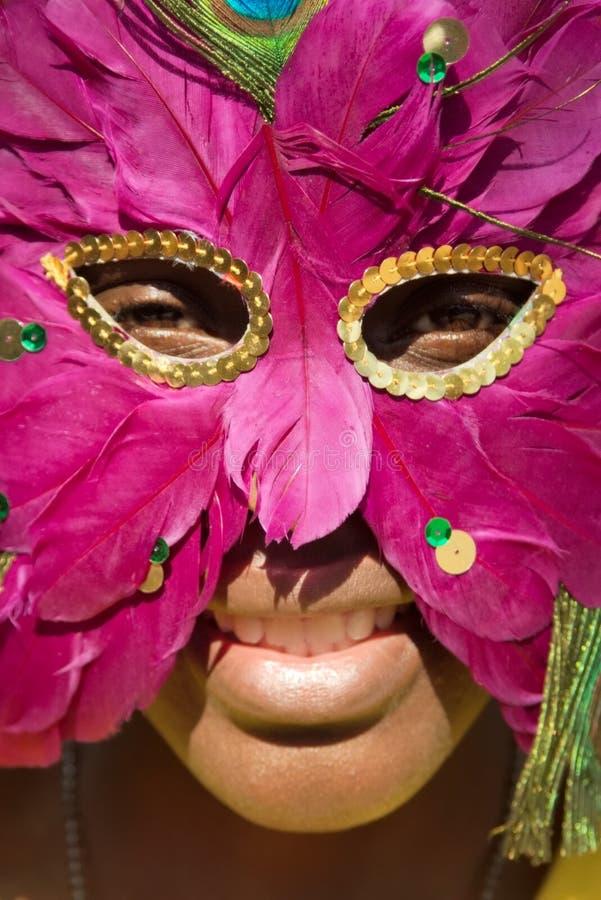 Jong meisje met masker stock afbeelding