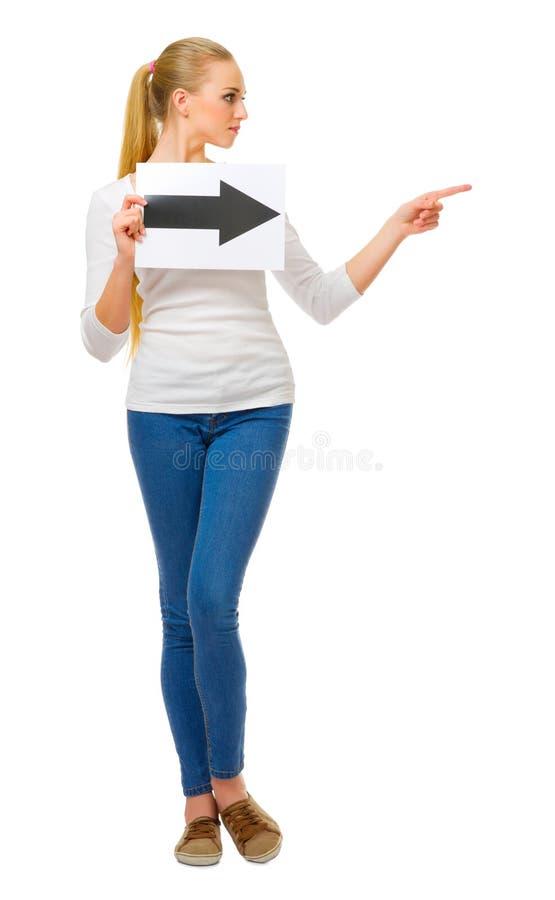 Jong meisje met pijl juist aanplakbiljet royalty-vrije stock foto's