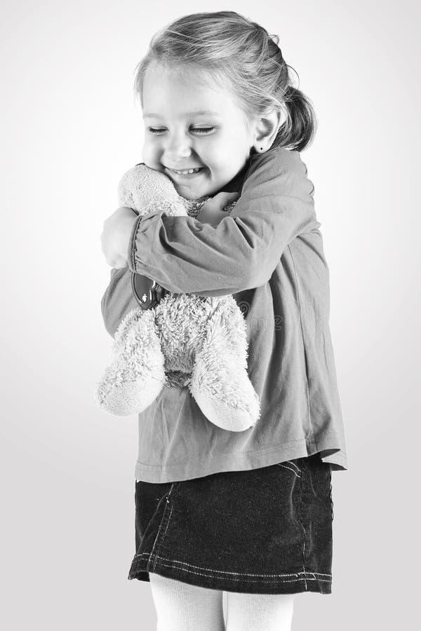 Jong meisje met teddybeer royalty-vrije stock fotografie