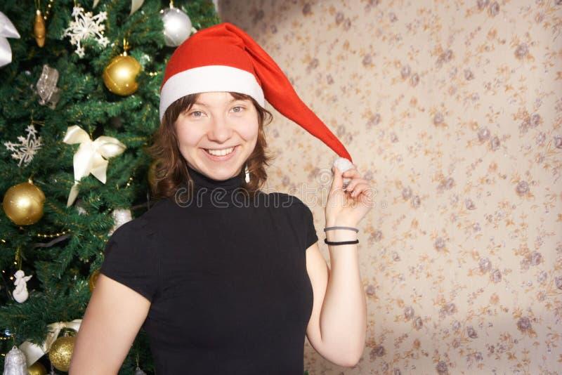 Jong meisje Nieuw jaar De kerstboom stock foto's