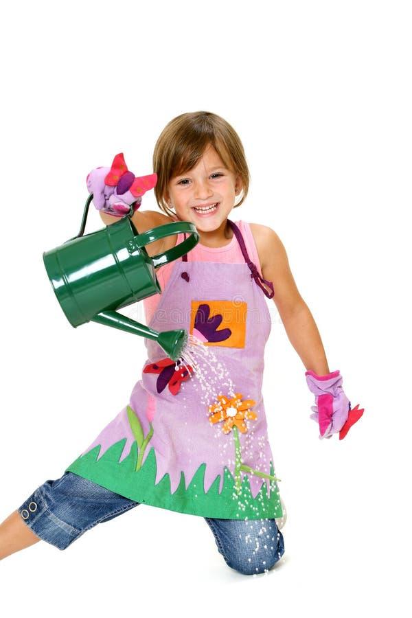 Jong meisjes gietend water royalty-vrije stock foto's