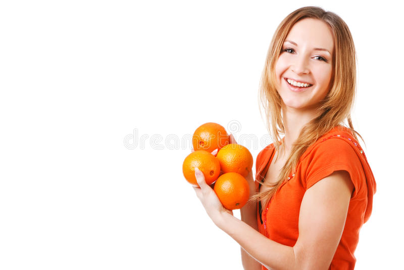 Jong mooi meisje in kleding met sinaasappelen stock afbeeldingen