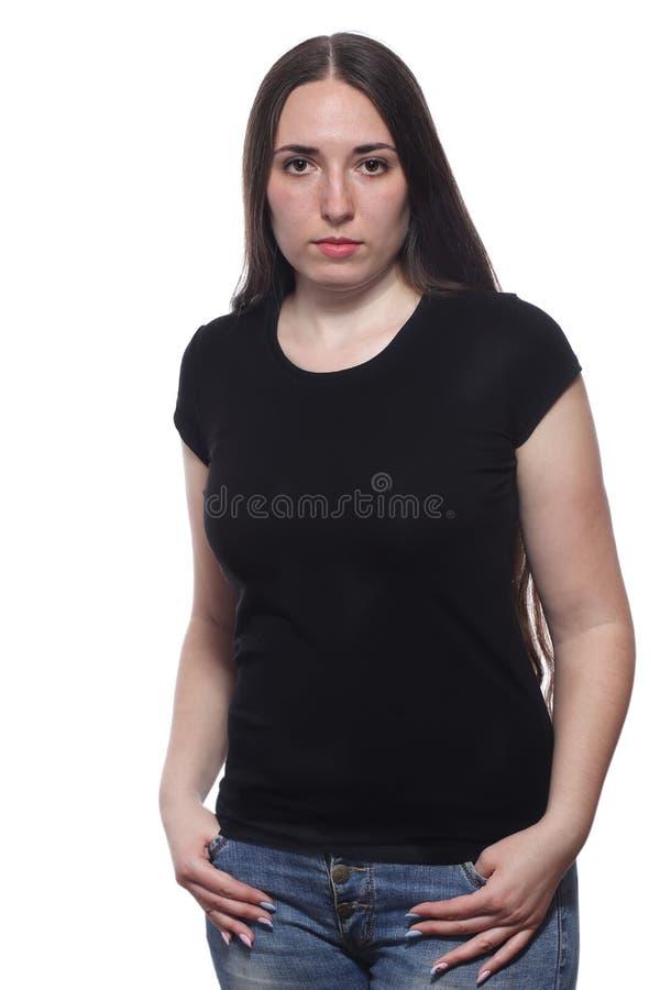 Jong mooi wijfje met leeg zwart overhemd dat op wit wordt geïsoleerd stock afbeelding