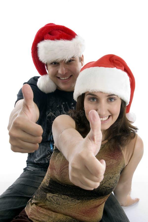 Jong paar dat Kerstmiswensen wenst stock afbeelding