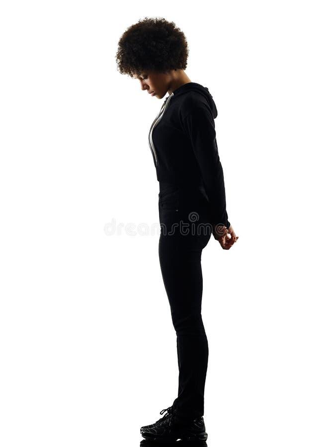 Jong van de de vrouwen bevindend droefheid van het tienermeisje de schaduwsilhouet ISO stock afbeelding