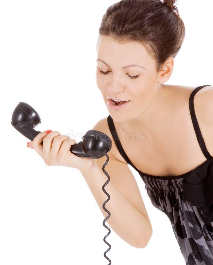 Jong verleidelijk meisje dat bij de telefoon roept royalty-vrije stock foto