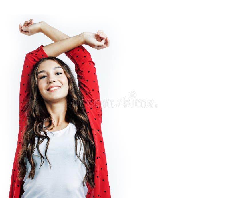 Jong vrij modieus hipstermeisje die emotioneel stellen ge?soleerd op witte achtergrond gelukkige het glimlachen koele glimlach, l stock fotografie