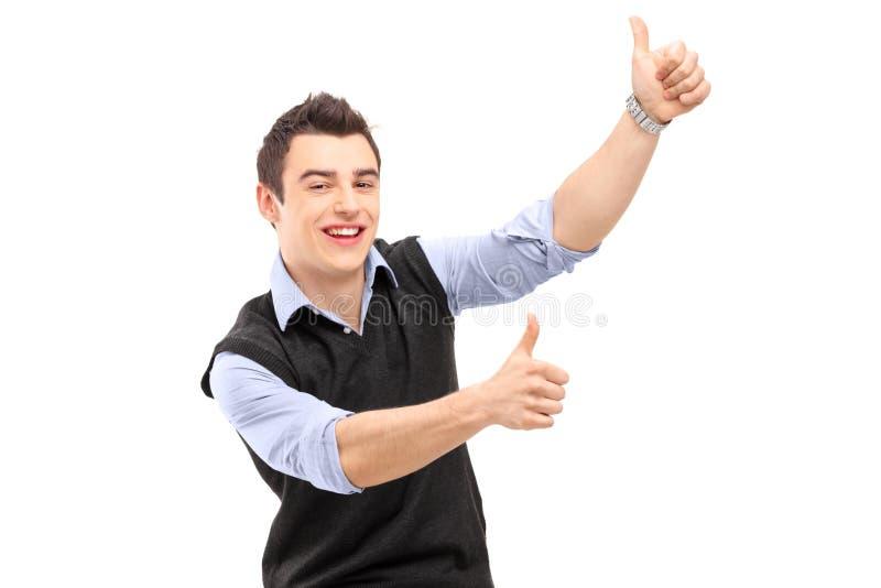 Jong vrolijk mensen gesturing geluk met omhoog duimen royalty-vrije stock foto's