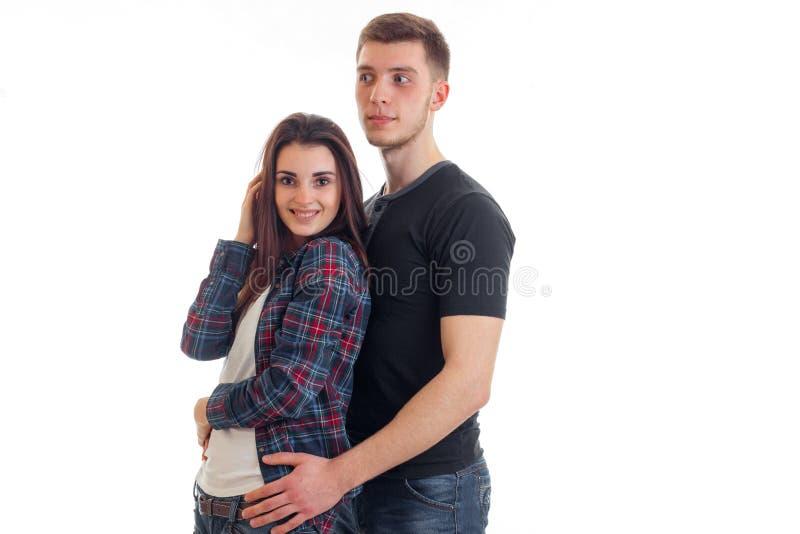 Jong vrolijk paar zich en glimlachend meisje die verenigen stock afbeeldingen