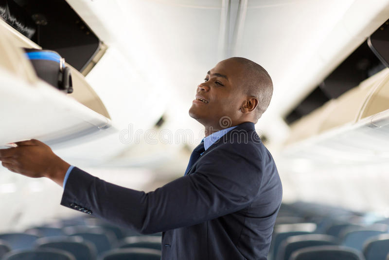 Jong zakenmanvliegtuig royalty-vrije stock fotografie