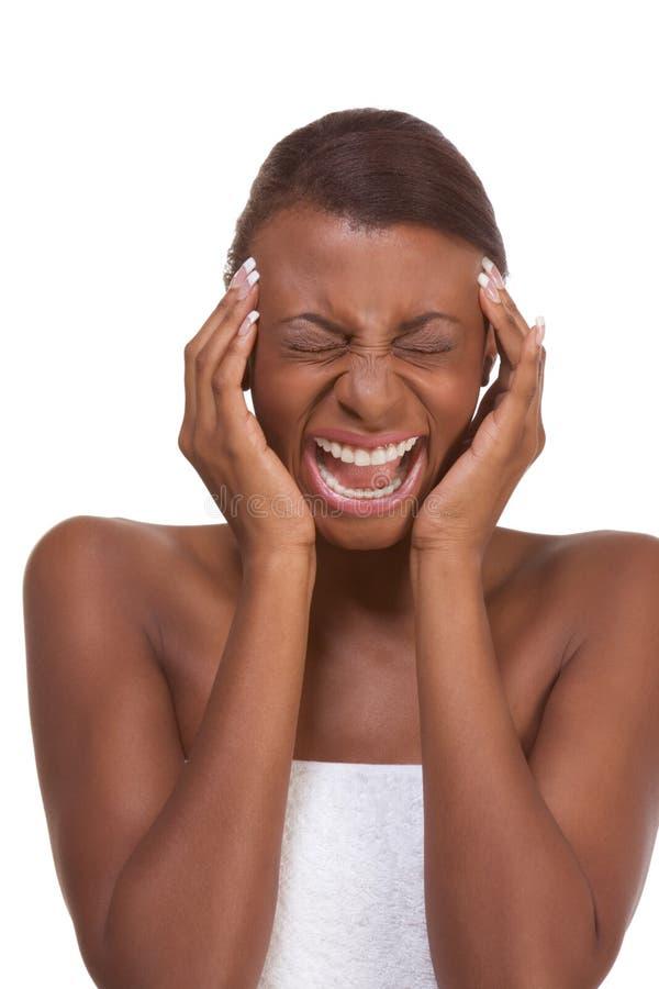 Jonge aantrekkelijke vrouw die aan hoofdpijn lijdt royalty-vrije stock foto
