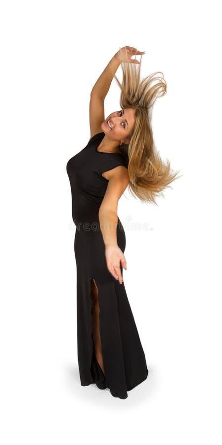 Jonge aantrekkelijke vrouw in lange avond zwarte kleding royalty-vrije stock foto's