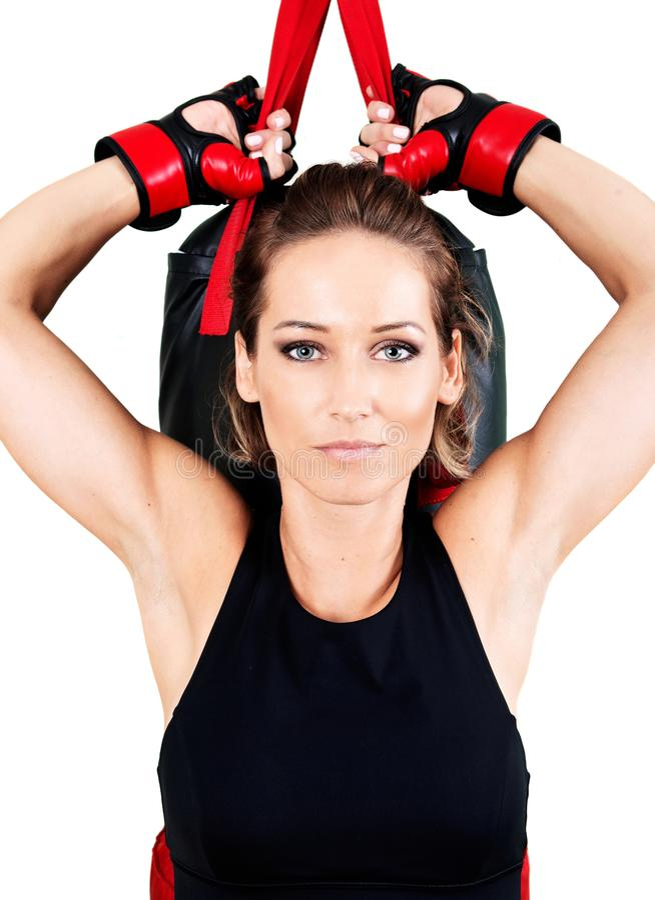Jonge actieve vrouwentraining: het cardio kickboxing, ponsenzak stock foto's
