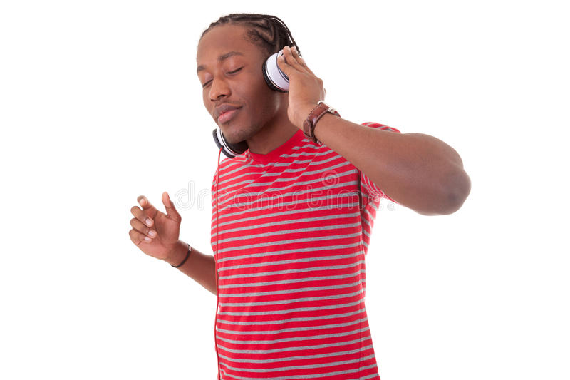 Jonge Afrikaanse Amerikaanse mens met hoofdtelefoons - Zwarte mensen stock foto's