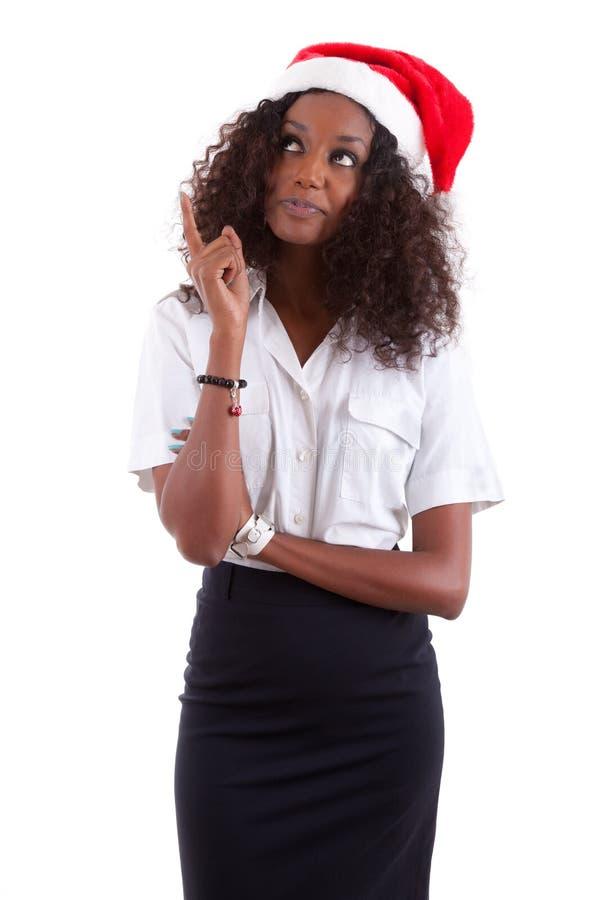 Jonge Afrikaanse Amerikaanse vrouw die een santahoed draagt stock afbeelding