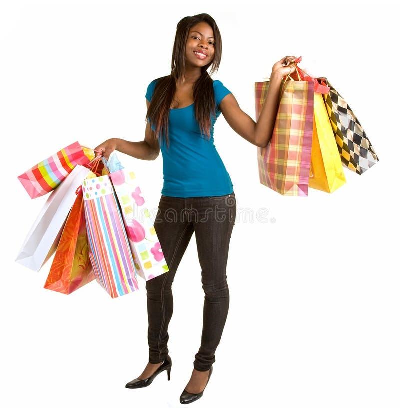 Jonge Afrikaanse Amerikaanse Vrouw op een Aanval van koopwoede stock foto