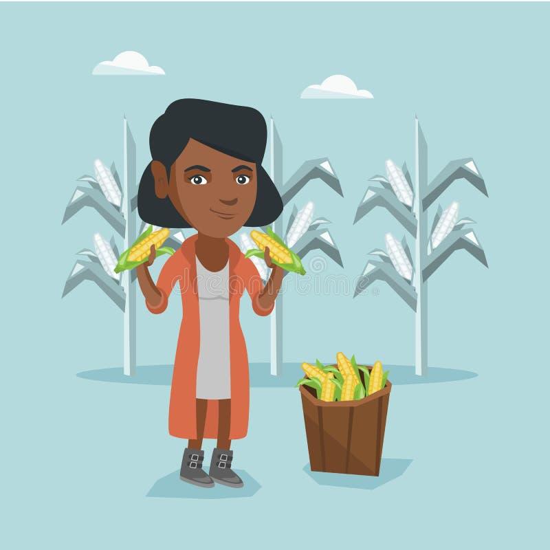 Jonge Afrikaanse landbouwer die graanoogst verzamelen royalty-vrije illustratie