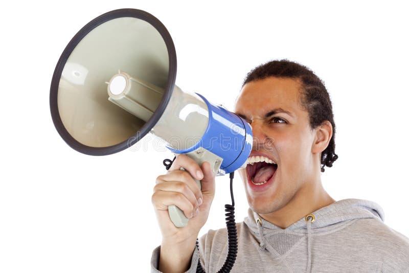 Jonge, Afrikaanse mensenschreeuwen luid in megafoon royalty-vrije stock foto