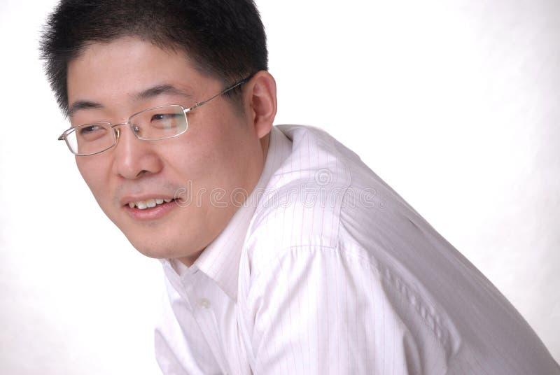Jonge Aziatische mens in glazen stock fotografie