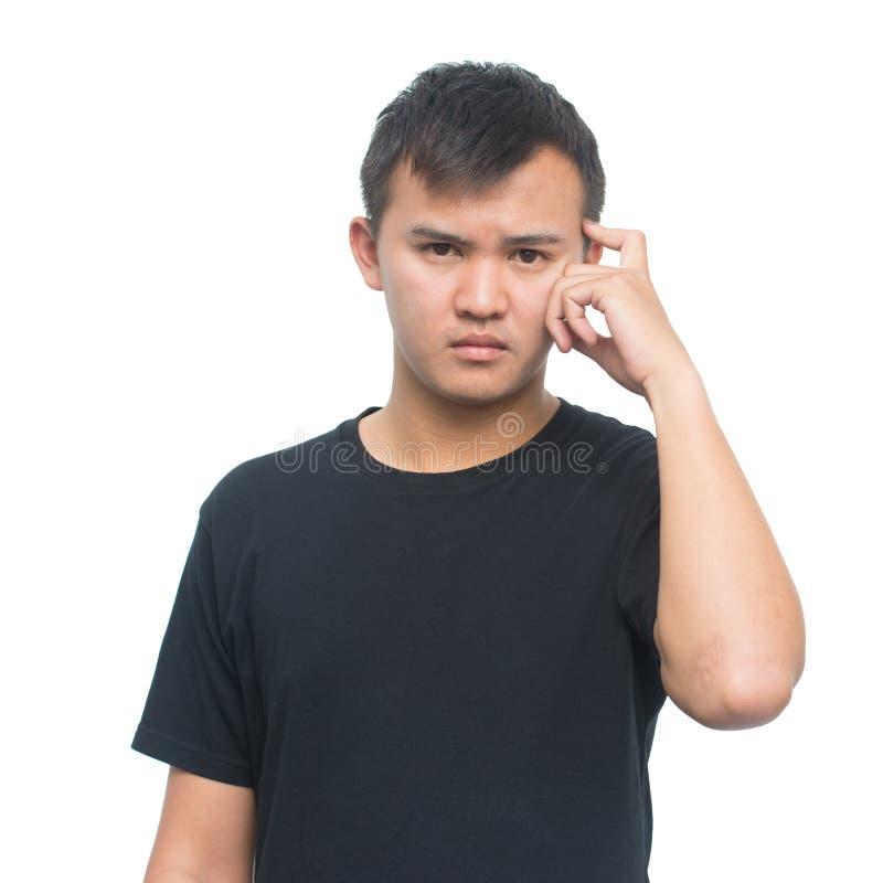 Jonge Aziatische mens met nadenkende uitdrukking stock fotografie