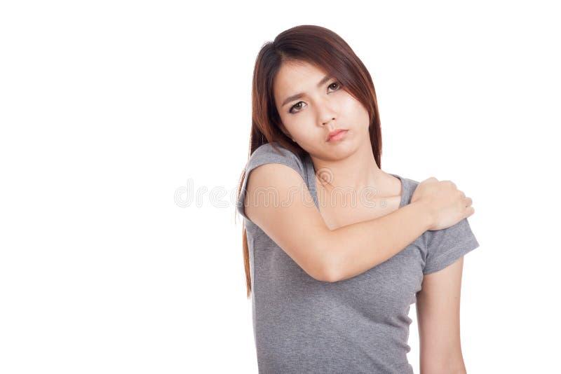 Jonge Aziatische vrouw geworden schouderpijn royalty-vrije stock foto