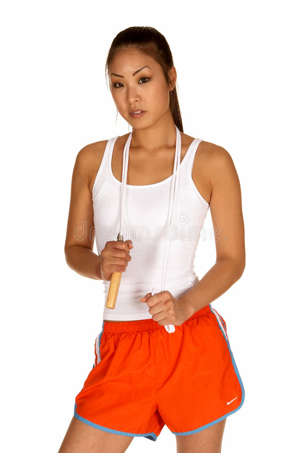 Jonge Aziatische Vrouw met Springtouw stock foto