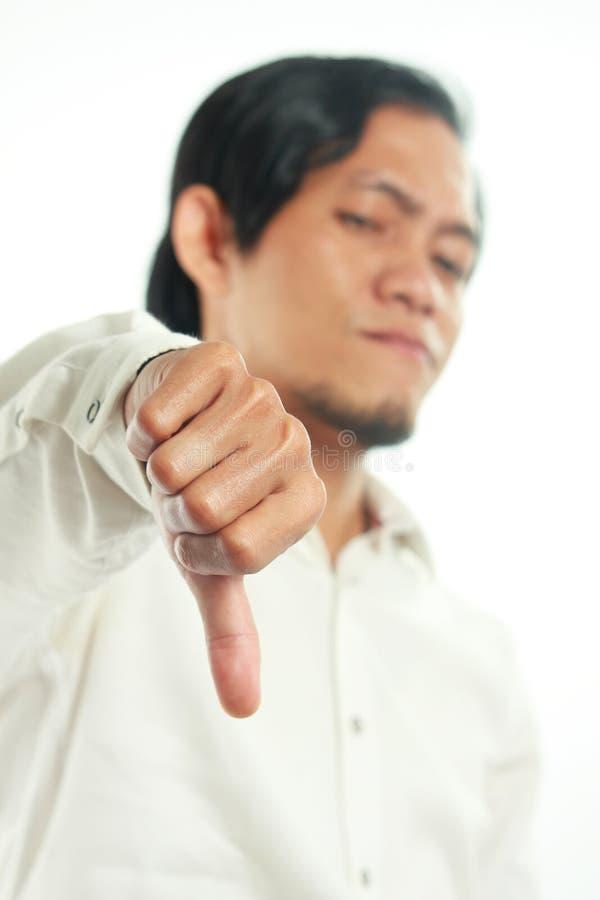 Jonge Aziatische Zakenman Showing Thumb Down royalty-vrije stock fotografie